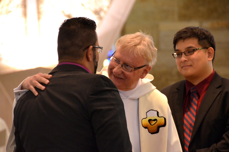 Fr. Jim Walters and Frater Joseph Vu congratulat Juancho — at Sacred Heart School of Theology.