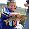 Colton Funk shows off his prized catch at the Fishing Derby.<br /> <br /> Photo by Chris Rourke