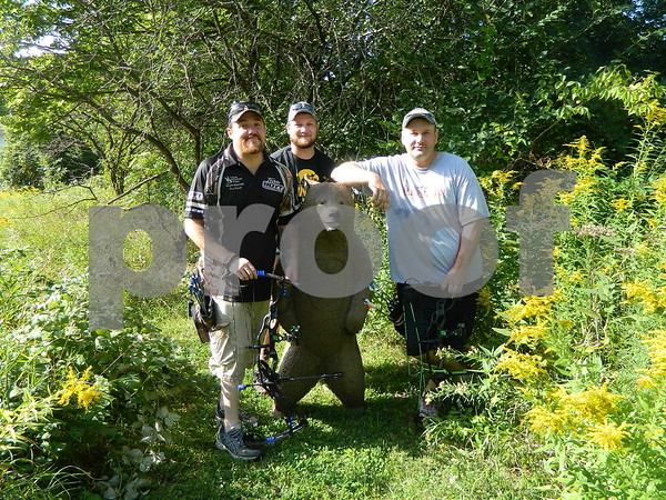Right to left: Ross Kunert, Deen Tompson, and Aaron McKinney posing by their next target.