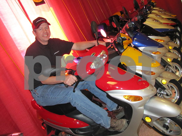 Jeff Schneider of Pocahontas Sales & Service sitting on one the MotoFino bikes he sells.