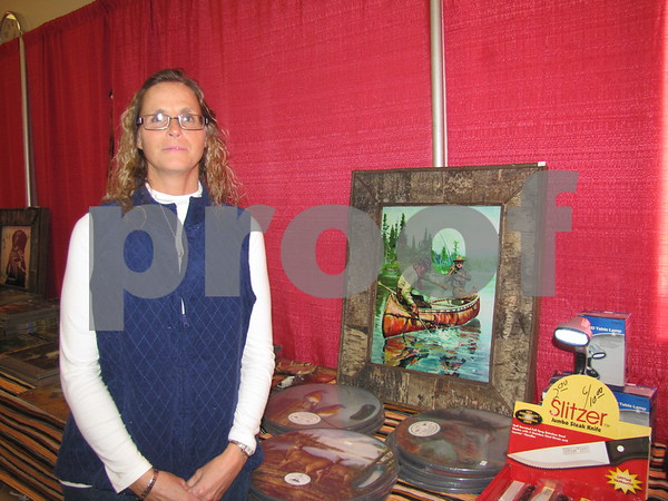 Beverly Post of Des Moines sells outdoor sports themed art work, cutting boards, cutlery, thermometers, and clothing.