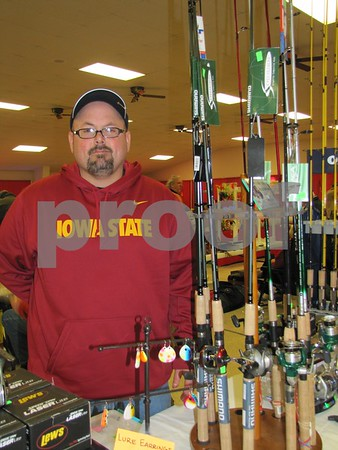Shannon Minshall of West Des Moines was set up at the Fort Dodge Sportsman's Show with his tackle.