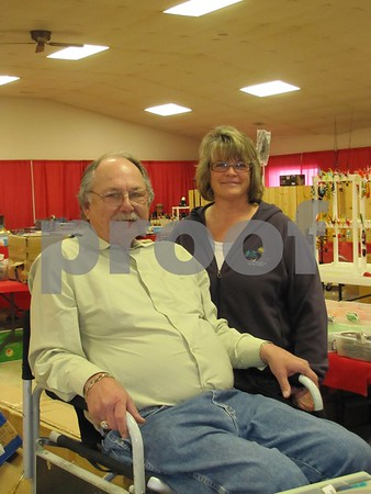 Roger Murray and Paula Griggs of Iowa Liquidation were at the Fort Dodge Sportsman's Show with their fishing equipment.