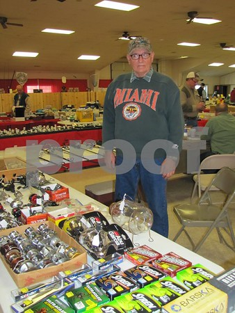 Jim Ahlberg of Marshalltown stands behind some of the hunting and fishing items he had at his booth at the Fort Dodge Sportsman's Show.