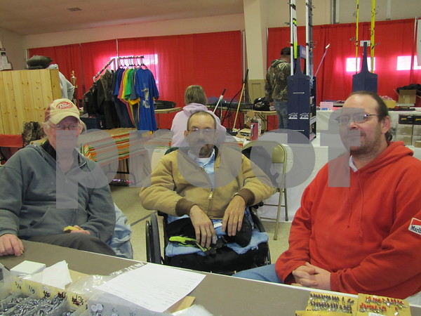 John Welch, Keith Knoll, and David Moore in their booth selling handmade sinkers.