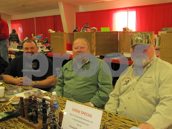 Jeremy Adams of Adams Custom Calls, Ken Crouse and Larry Crouse of Crouse Brothers Calls, at their booth at the Fort Dodge Sportsman's Show at the Webster County Fairgrounds.  The three men make custom calls for waterfowl hunters.