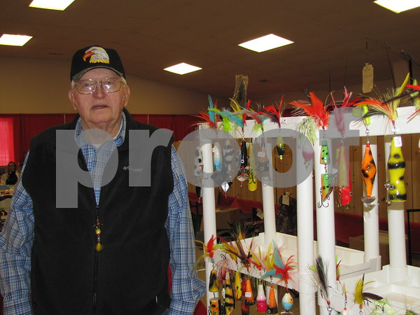 Gary Zumach of Zumach Sales in Lake View stands next to a large display of his handmade lures.