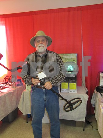 Greg Gust, Double Eagle Detector Co., holding one of the metal detectors he sells.