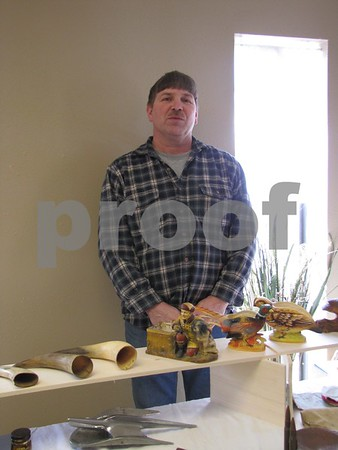 Jon Olson with his display of collectibles.