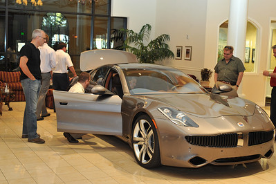 "First photo of Fisker Karma Electric Hybrid Tour Launch in USA first stop on tourat Gaudin Autos in Las Vegas. DSM Luxury is proud to present the opening tour launch of the world's first luxury hybrid car Frisker Karma made by Danish man Henrik Fisker in Irvine, California. Here is a video of Henrik Fisher talking about his electric hybrid Karma: http://www.youtube.com/watch?v=sLq2keRz9l0&feature=player_embedded ""Follow The Fun With DSM"" DSM Website - Sign up for more events - http://www.dsmlasvegas.com/ Photograph by Las Vegas photographer Mark Bowers. www.ReallyVegasPhoto.com"