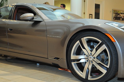 "First photo of Fisker Karma Electric Hybrid Tour Launch in USA first stop on tourat Gaudin Autos in Las Vegas. DSM Luxury is proud to present the opening tour launch of the world's first luxury hybrid car Frisker Karma made by Danish man Henrik Fisker in Irvine, California. Here is a video of Henrik Fisher talking about his electric hybrid Karma: http://www.youtube.com/watch?v=sLq2keRz9l0&feature=player_embedded ""Follow The Fun With DSM"" Photograph by Las Vegas photographer Mark Bowers."