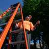 "5/14/16 FITCHBURG-- ""Better together.""  Roberto Cespedes is the Director of Operations for the Crossroads Community Church which hosted Fitchburg's city wide clean up on Satuday.  Roberto is calling out raffle ticket's on top of a ladder before the volunteers went off to their assigned locations.  Sentinel & Enterprise Photo/Jeff Porter"