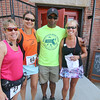 Sue Collura of Fitchburg, Denise Lawson of Uxbridge and Deb Fontaine of Leominster pose with Sgt. Mark Jackson one of the organizers of the Fitchburg Police Relief Association 5K road race. This is the 24 years for this race. This Years money raised will go to supporting the Veterans Homestead. SENTINEL & ENTERPRISE/JOHN LOVE