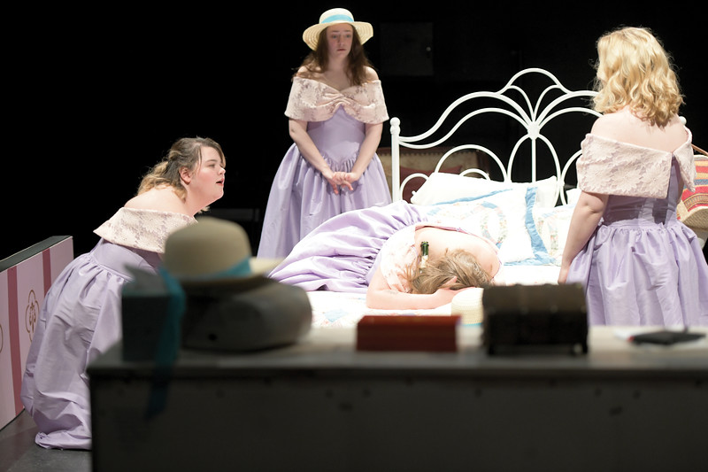 "Matthew Gaston | The Sheridan Press<br> During the dress rehearsal for Sheridan College's ""Five Women Wearing the Same Dress"" in the Mars Theater at the WYO Performing Arts and Education Center Tuesday, April 9, 2019, Georgeanne, played by Marlee Holdeman, sobs into the bed while, from left, Meredith, played by Emily Kidneigh; Frances, played by Nicolette Krumberger; and Trisha, played by Victoria Waterhouse, look on in suprise and try to comfort her.  The play will run Thursday through Saturday at the WYO."
