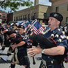 MIKE McMAHON - MMcMAHON@DIGITALFIRSTMEDIA.COM, The Quaboag Highlanders Pipes and Drums march in the 48th flag day parade in Troy, Sunday June 14, 2015