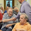 Beacon Hospice Chaplain Robert Girard thanks Fred Boxil during a Flag Day ceremony that was held for veterans at the Golden Living Center in Fitchburg on Friday afternoon. SENTINEL & ENTERPRISE / Ashley Green