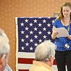 """Alyssa Martin reads """"I am the flag"""" at a Flag Day ceremony that was held for veterans at the Golden Living Center in Fitchburg on Friday afternoon. SENTINEL & ENTERPRISE / Ashley Green"""