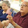 Forrest LaValley is handed a flag during a Flag Day ceremony that was held for veterans at the Golden Living Center in Fitchburg on Friday afternoon. SENTINEL & ENTERPRISE / Ashley Green