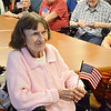Maragret Delay, a WWII Veteran of the U.S. Navy, holds her flag during a Flag Day ceremony that was held for veterans at the Golden Living Center in Fitchburg on Friday afternoon. SENTINEL & ENTERPRISE / Ashley Green
