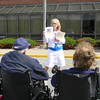 Activities director Kathy Bungard gives a brief talk on the history of the flag. — Dan Irwin