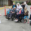 Kathy Bungard leads the residents in prayer to conclude the Flag Day observance. — Dan Irwin