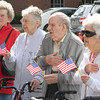 Reciting the Pledge of Allegiance are, from left, Betty Yeager, Marge Book, John Irace and Clara Goff. — Dan Irwin