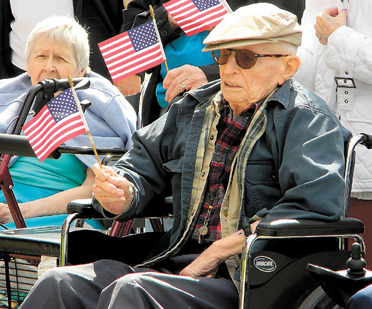 Dan Irwin/NEWS<br /> Henry Walp, who will celebrate his 98th birthday this week, proudly waves the Stars and Stripes during a Flag Day observance at Southpointe at Jameson.