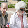 John Irace and Clara Goff sing one of several patriotic songs that were a part of the ceremony. — Dan Irwin