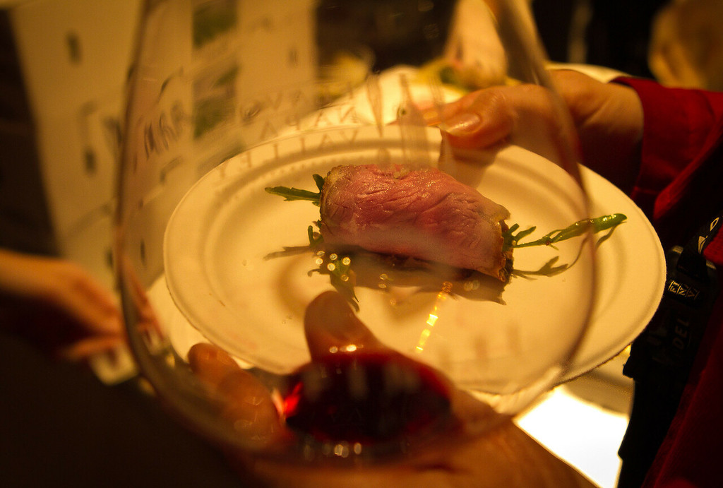 A guest whisks away a Smoked Sirloin Carpaccio at the Napa Flavor Gala being held at the CIA Greystone in St. Helena, Calif., on November 18th, 2011.