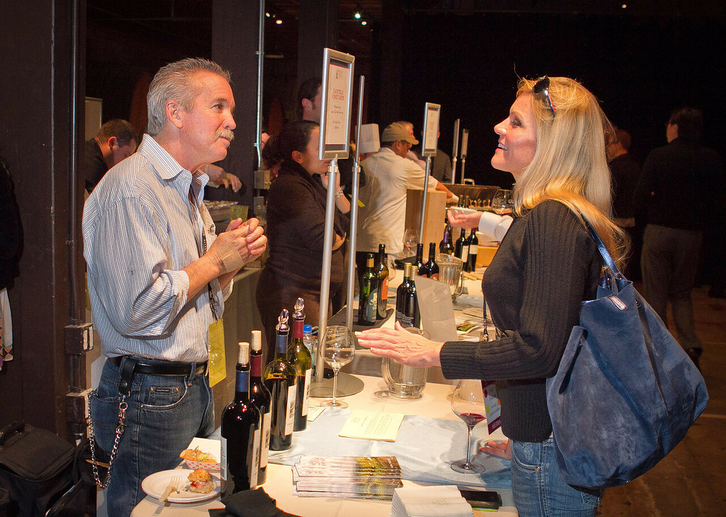 Mike Swanson, owner of Zahtila Vineyard, talks about his wines with Val Fulton at the Napa Flavor Gala being held at the CIA Greystone in St. Helena, Calif., on November 18th, 2011.