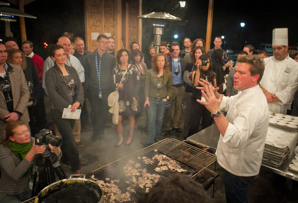 Chef Tyler Florence talks with guests about grilling squid at the Napa Flavor Gala being held at the CIA Greystone in St. Helena, Calif., on November 18th, 2011.