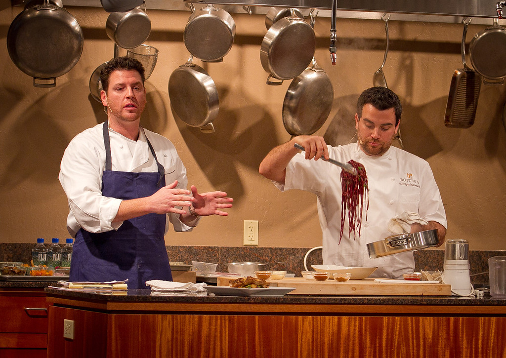 Chef Scott Conant (left) helps Bottega Restaurant's Culinary Director Ryan McIllwraith with a cooking demonstration during the Napa Flavor event being held at the CIA Greystone  in St. Helena, Calif.,  on Saturday, November 19th, 2011.