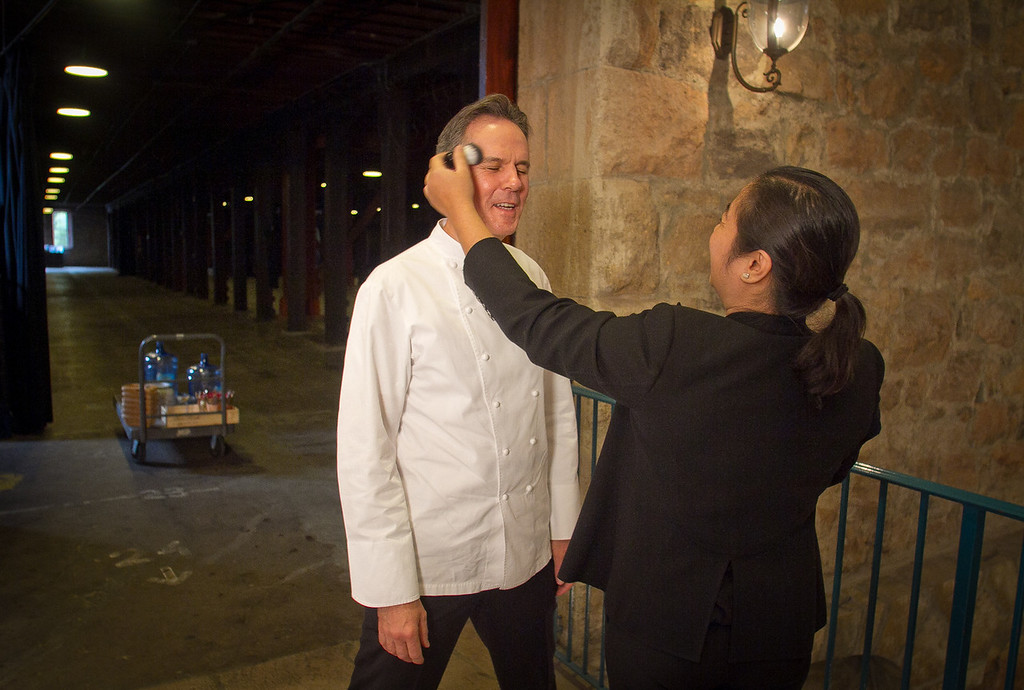 Chef Thomas Keller gets powder before going on camera at the Napa Flavor event being held at the CIA Greystone  in St. Helena, Calif.,  on Saturday, November 19th, 2011.