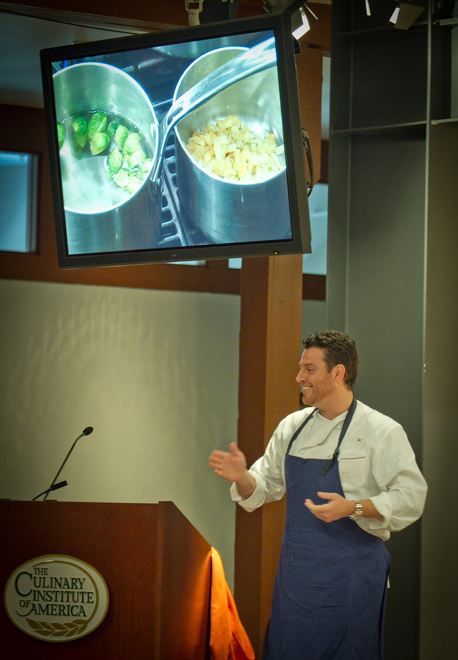 Chef Scott Conant talks during a cooking demonstration during the Napa Flavor event being held at the CIA Greystone  in St. Helena, Calif.,  on Saturday, November 19th, 2011.