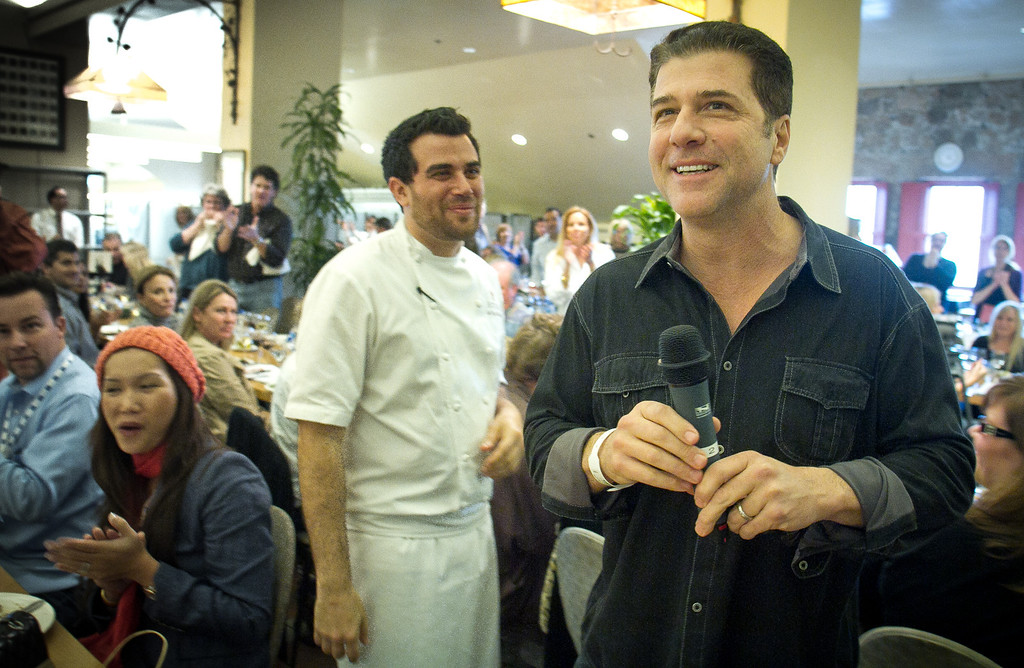 Michael Chiarello and Ryan McIllwraith talk with attendees at his interactive lunch after just being released from the hospital for an appendectomy at the Napa Flavor event being held at the CIA Greystone  in St. Helena, Calif.,  on Saturday, November 19th, 2011.