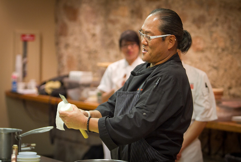 Chef Masahara Morimoto prepares pasta during his cooking demonstration at the Napa Flavor event being held at the CIA Greystone  in St. Helena, Calif.,  on Saturday, November 19th, 2011.
