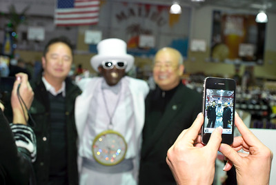 Kinny Lee and father of Lees Discount Liquors in this photograph with Flavor Flav.