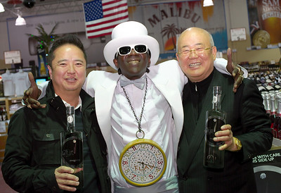 Kinny Lee and father of Lees Discount Liquors in this image with Flavor Flav.
