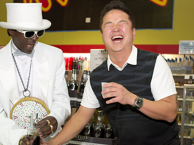 Kinny Lee of Lees Discount Liquors in this photograph with Flavor Flav.