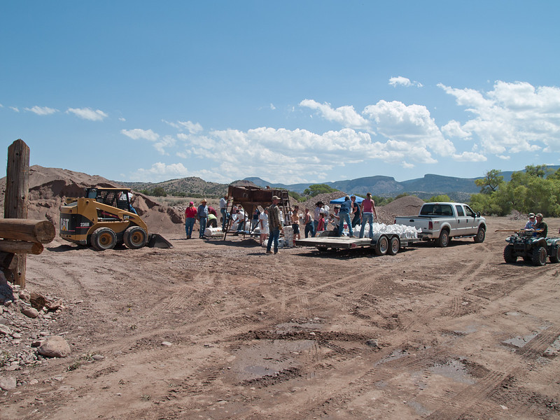 Sandbagging at Mineral Creek, Alma, NM.<br /> The location is a small sand and gravel operation. Materials and equipment donated by the owner.<br /> Labor and vehicles donated by local folks, many of whom live outside the danger zone.