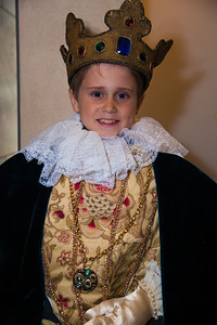 "Aiden (9) of Silver Spring MD tries on a crown in ""Shakespeare's Dressing Room"""
