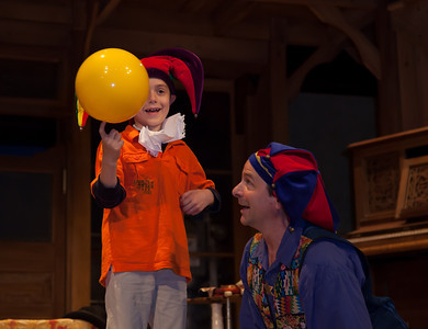 Nick Newlin and Joanne Flynn of The Nicolo Whimsey Show (jesters and Jugglers) perform in the Folger Theatre with young Aaron.