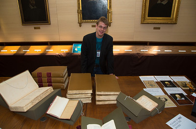 "Alan Katz , Circulation assistant of the ""Books before Modern"" Collection shows off part of the Folger's vast collection of rare books"