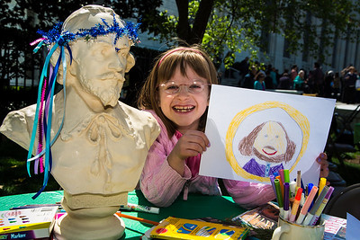 Molly (age 7) shows off her portrait of William Shakespeare