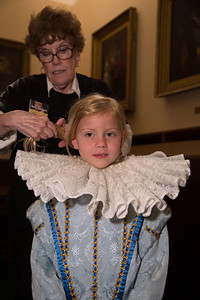 Marilyn Eisenhardt  Senior docent helps prepare Claire (age 7 1/2) try on an Elizabethan costume