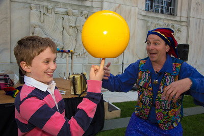 Joseph (age 5) gets a balancing lesson from Nick Newlin of the Nicolo Whimsey Show