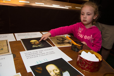 Caroline (age 5) examines part of the Folger collection.