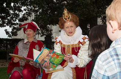 Queen Elizabeth I portrayed by Penelope Rahming is a DC Public Library Storyteller, hear reading to Audrey Neumann (age 7) of D.C.