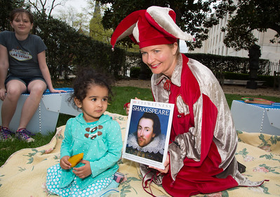 Kathleen Pugh as Feste.is a DC Public Library Storyteller, hear reading to Layla Nooruddin (age 2) of D.C.