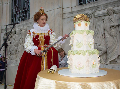 Queen Elizabeth I portrayed by Penelope Rahming cuts Shakespeare's birthday cake